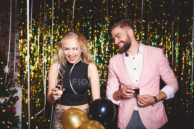 Man and woman at party — Stock Photo