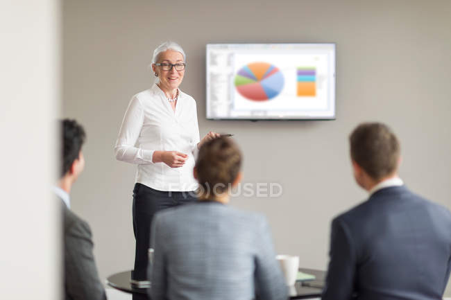 Mature businesswoman giving office presentation — Stock Photo