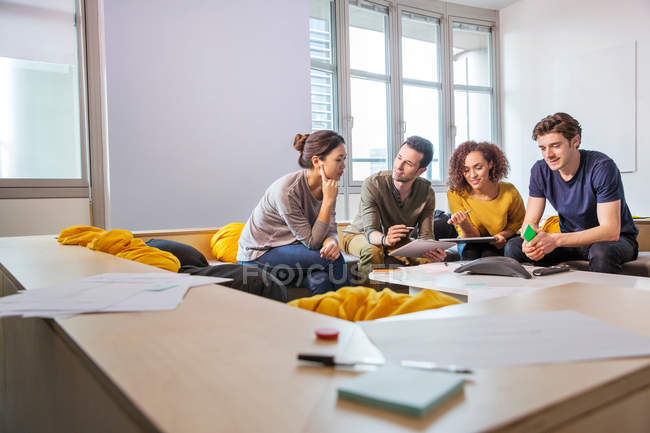 Digital designers on office sofa — Stock Photo
