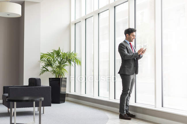 Businessman looking at smartphone — Stock Photo