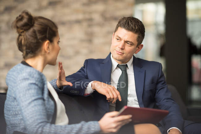 Businessman and woman meeting — Stock Photo