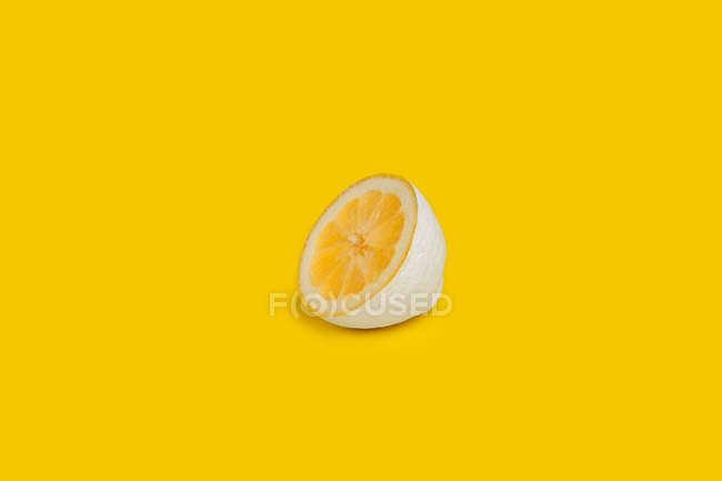 Half lemon painted white — Stock Photo