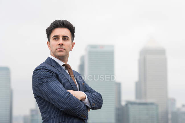Confident businessman with arms crossed — Stock Photo