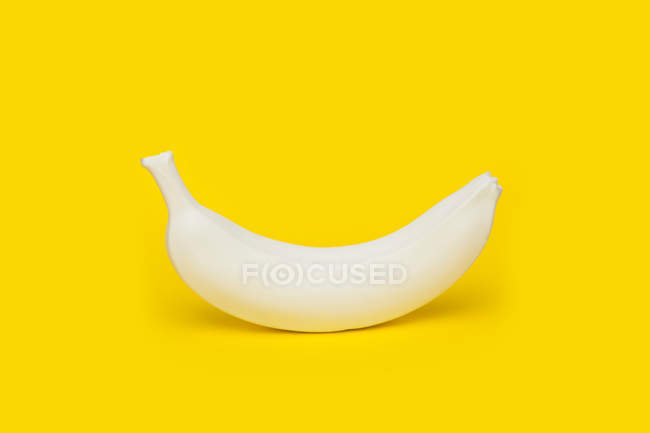 Banana painted white — Stock Photo