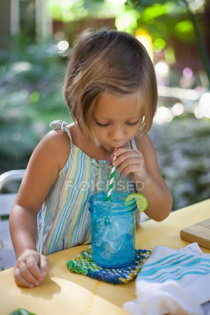 Girl drinking ice water — Stock Photo