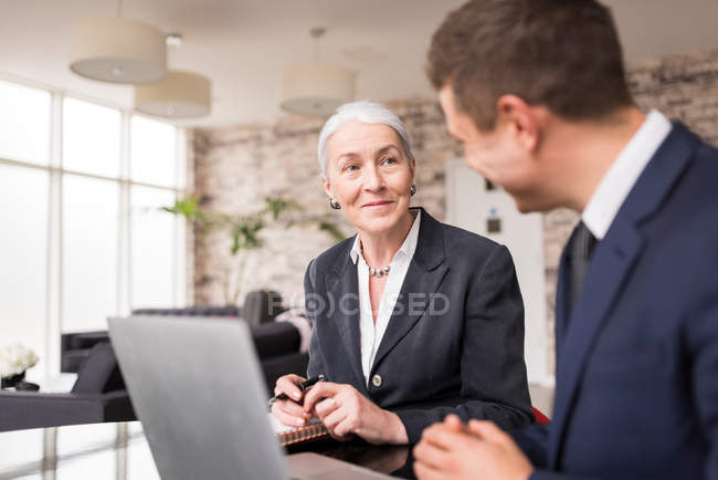 Businesswoman meeting male colleague — Stock Photo