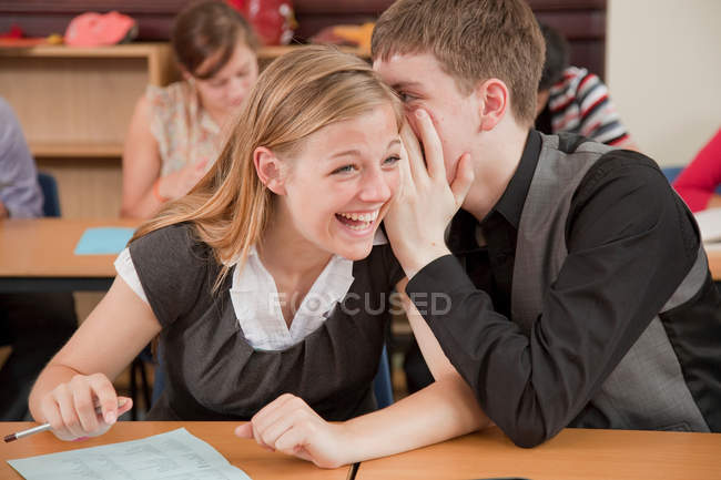 Two students share a secret — Stock Photo