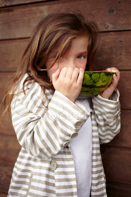 Portrait of girl eating watermelon — Stock Photo