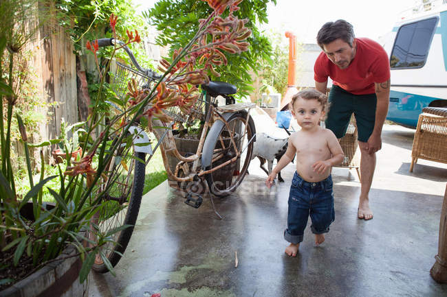 Son running on patio — Stock Photo