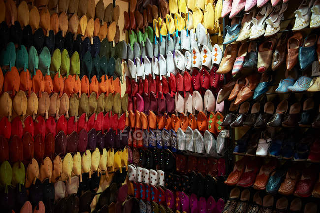 Wall full of colorful female shoes — Stock Photo