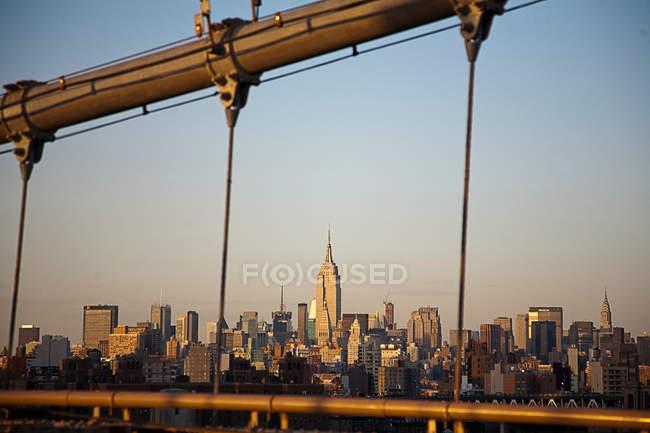 City skyline viewed from bridge — Stock Photo