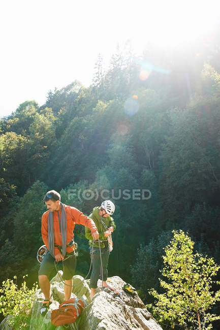 Two rock climbers standing on rocks — Stock Photo