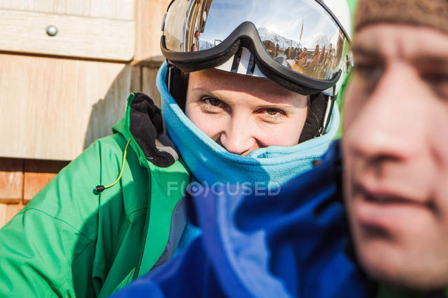 Female skier looking over male shoulder — Stock Photo