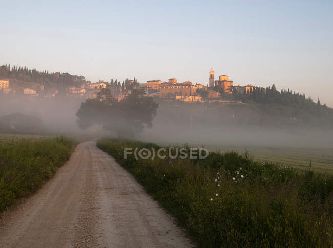 Country track with view of Solomeo village — Stock Photo