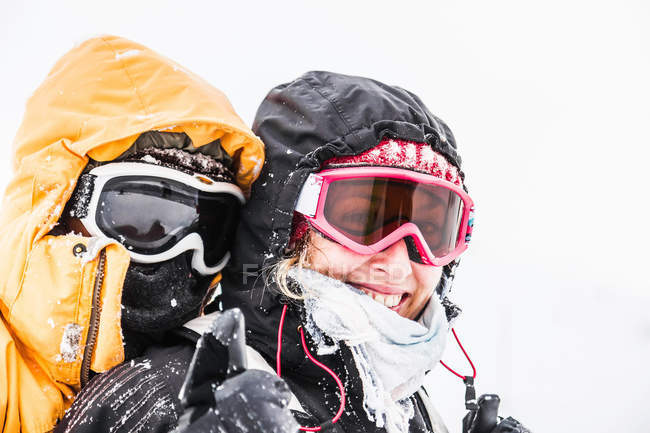 Young couple in skiing goggles — Stock Photo