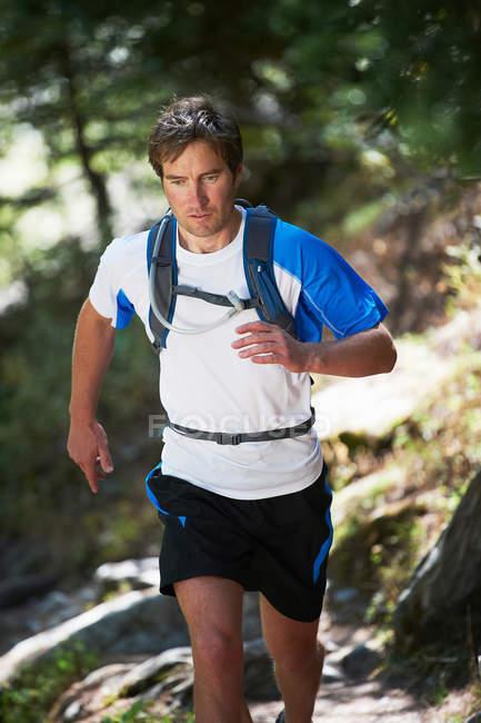 Man running in sunlight — Stock Photo
