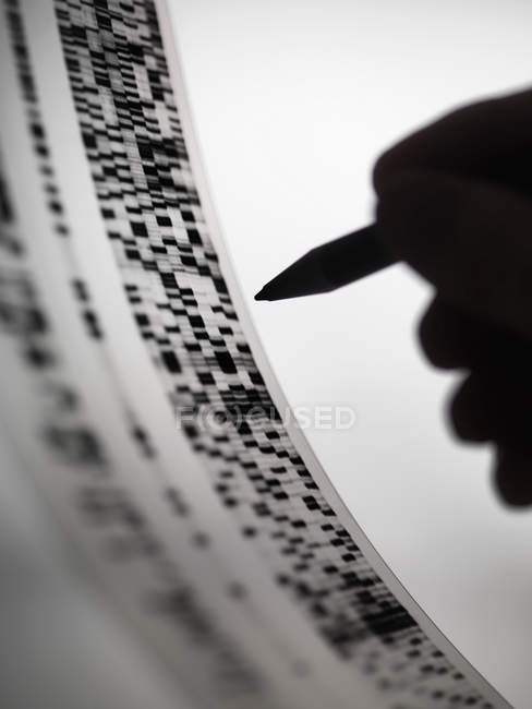 Cropped image of Scientist marking up DNA autoradiogram — Stock Photo