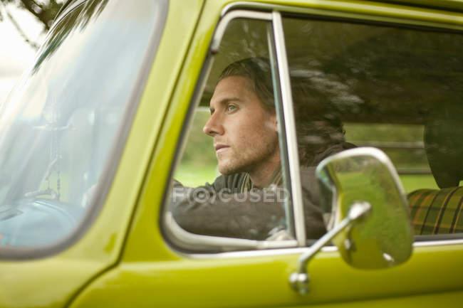 Man sitting in van — Stock Photo