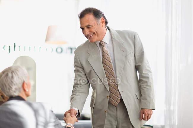 Businessman shaking colleague hand — Stock Photo