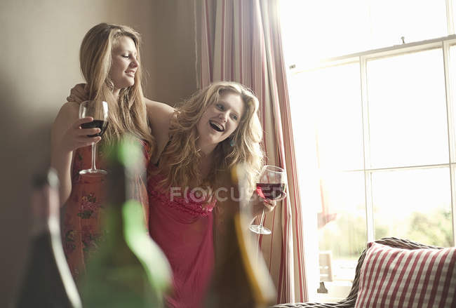 Teenage girls drinking red wine — Stock Photo