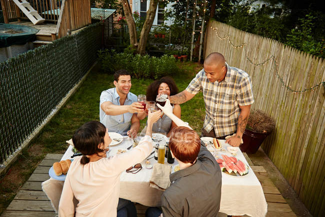 Group of people toasting with drinks — Stock Photo