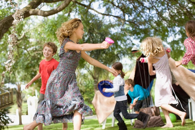 Children playing together on backyard — Stock Photo