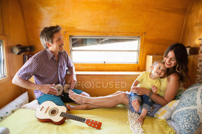 Parents and son resting in trailer home — Stock Photo