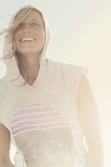 Smiling woman wearing hoodie — Stock Photo