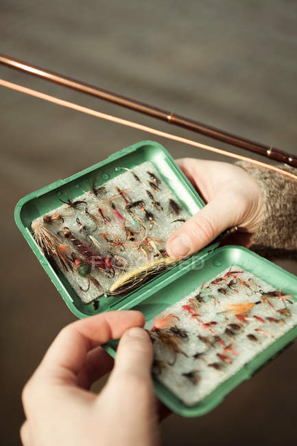 Male hands holding tackle box — Stock Photo