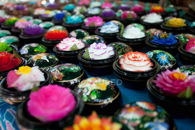 Flowers in ornate boxes — Stock Photo