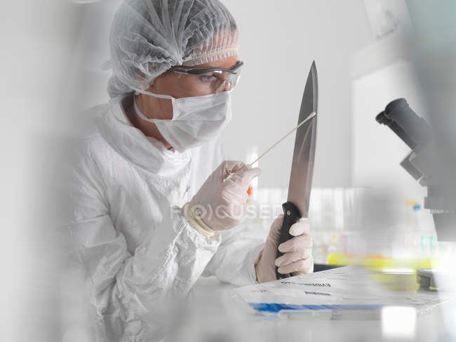 Forensic scientist with evidence — Stock Photo
