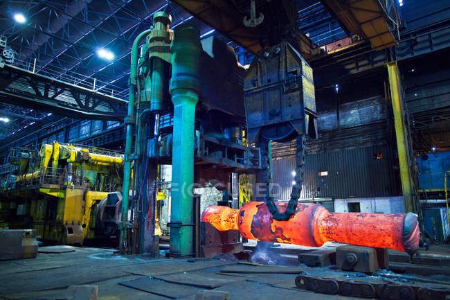 Glowing machinery in steel forge — Stock Photo