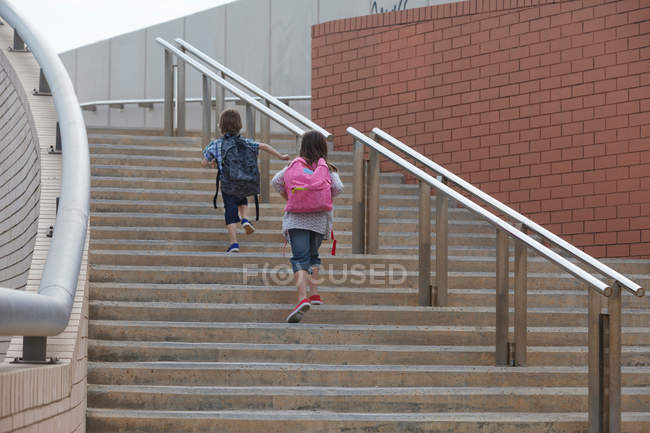 Children climbing stairs outdoors — Stock Photo