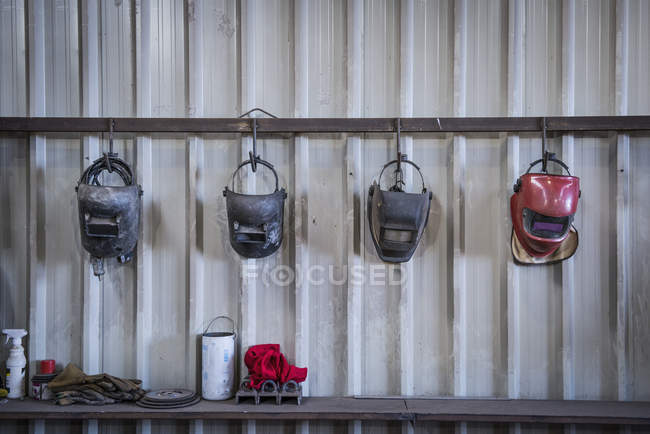 Welding masks in engineering workshop — Stock Photo