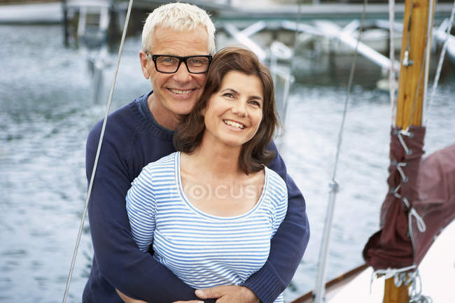 Middle aged couple on an old boat — Stock Photo