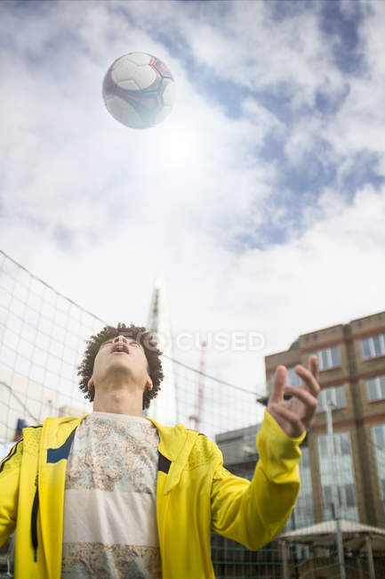 Young man practising football skills — Stock Photo