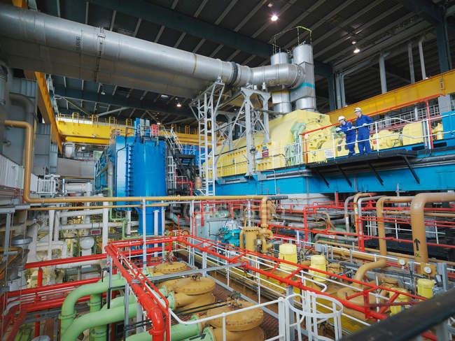Engineers standing in Turbine Hall — Stock Photo