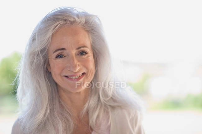 Older woman smiling outdoors — Stock Photo