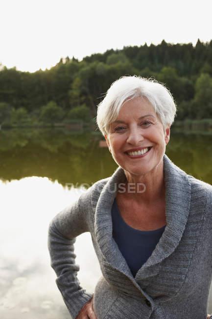 Senior woman portrait at the lake — Stock Photo