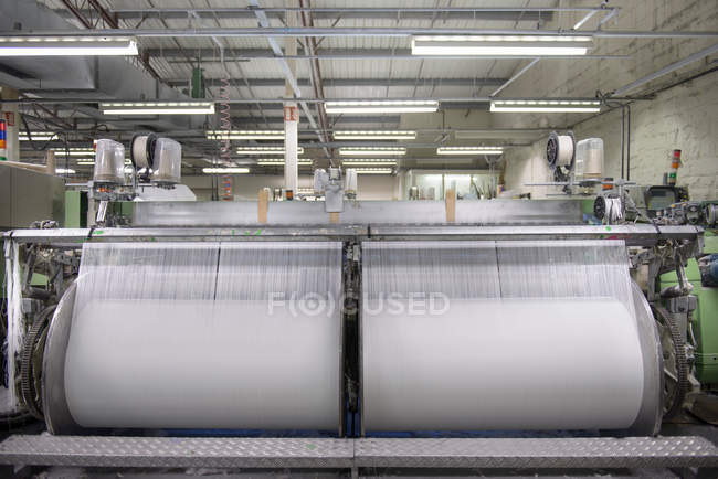 Industrial loom in textile mill — Stock Photo