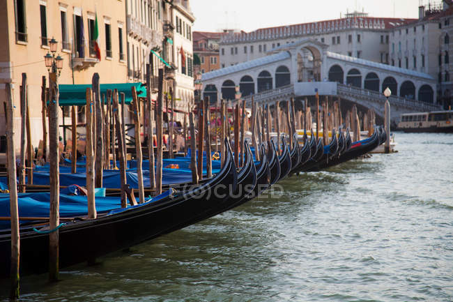 Gondolas docked on canal — Stock Photo