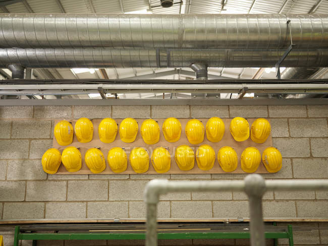 Rows Of Yellow Hard Hats — Stock Photo