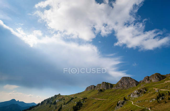 Rocky hilltop and blue sky — Stock Photo