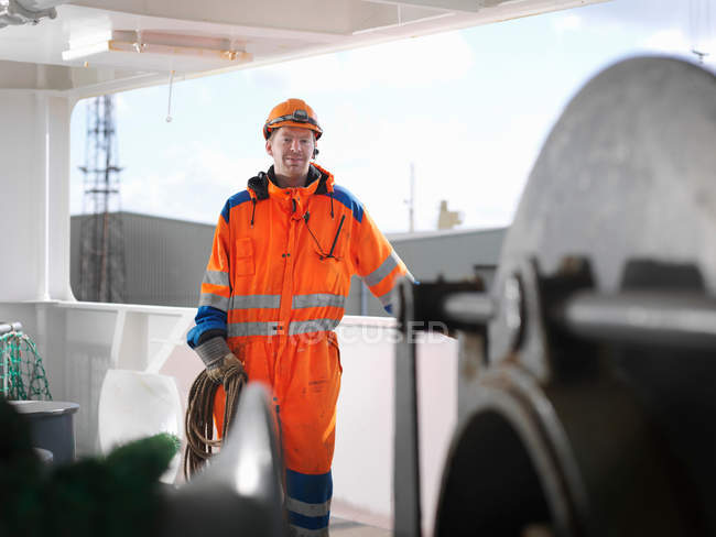 Sailor holding rope on deck — Stock Photo