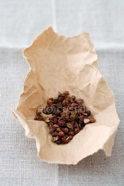 Szechuan pepper in paper — Stock Photo