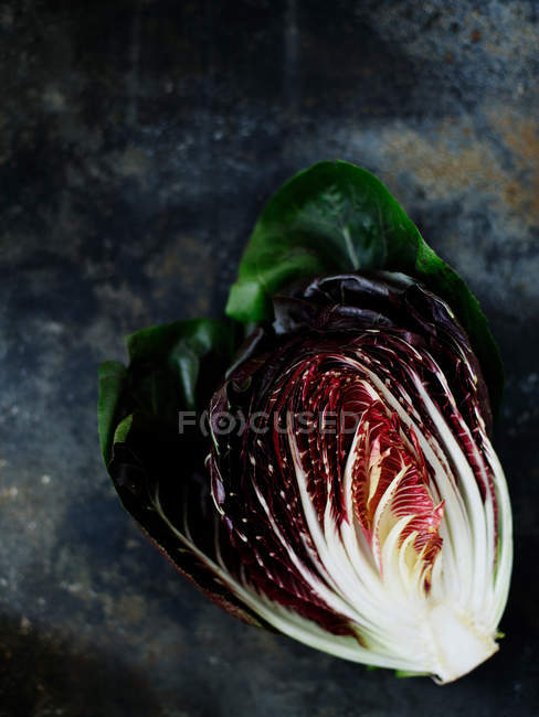 Colorful radicchio piece on stone — Stock Photo