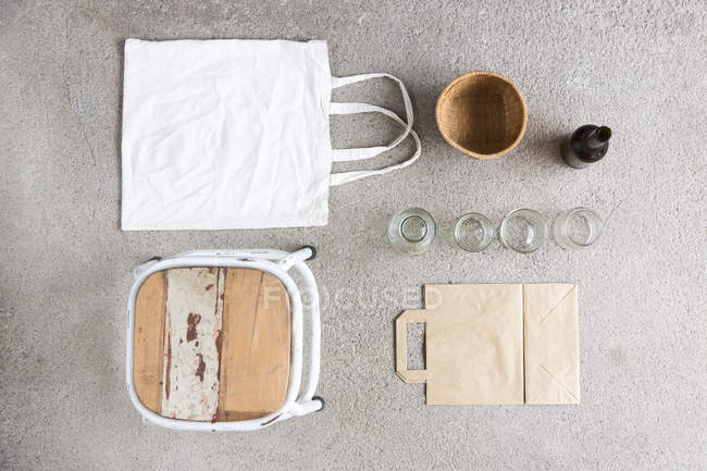 Overhead still life of stool, reusable shopping bag and recyclable paper and bottles — Stock Photo