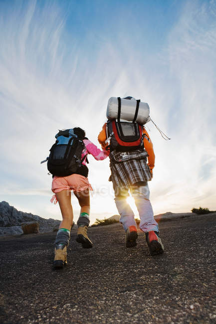 Rear view of man and woman hiking back view — Stock Photo