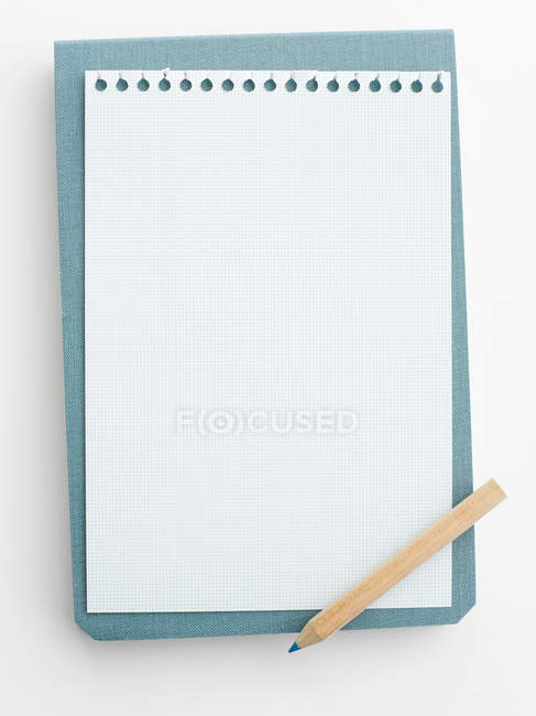 Blank notepad paper with pencil — Stock Photo