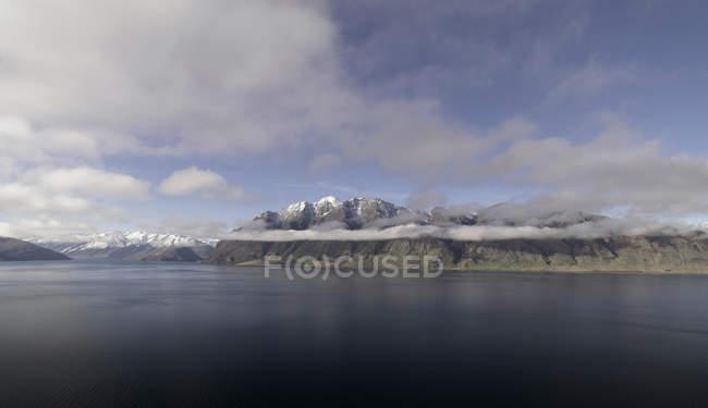 Still lake in rural landscape — Stock Photo